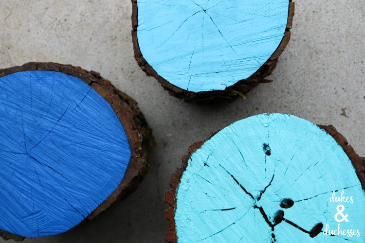 painted logs to use as stools