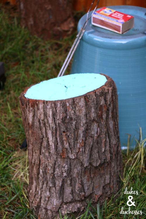 repurposed log stools around fire pit