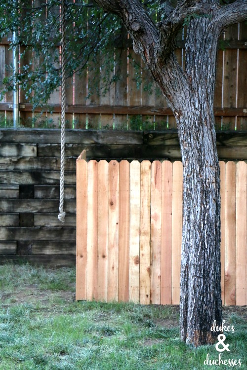wooden DIY fence to cover power boxes