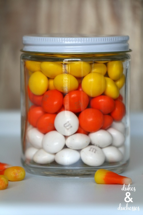 candy corn colored candies in a jar