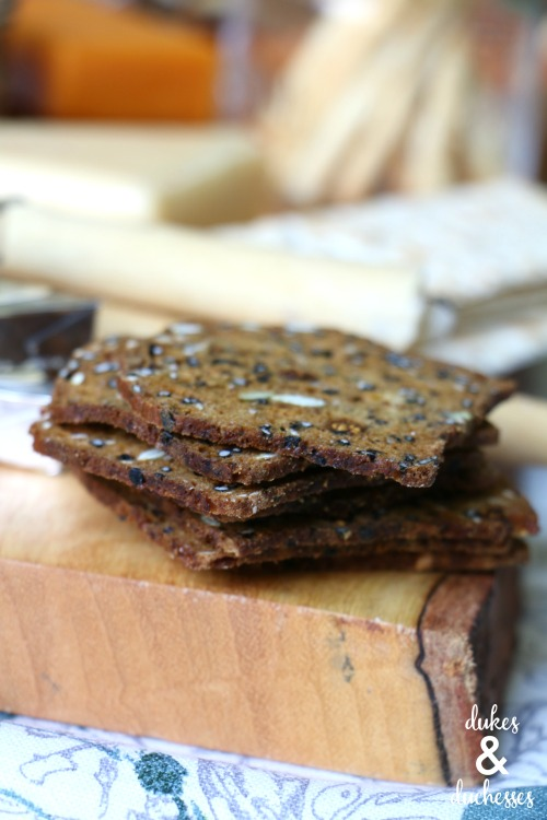 specialty crackers on a pantry cheese board