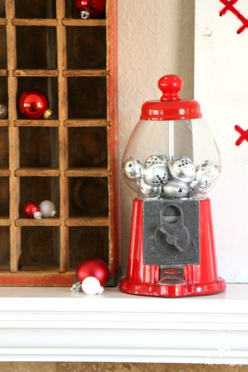 bubblegum machine with silver bells on christmas mantel