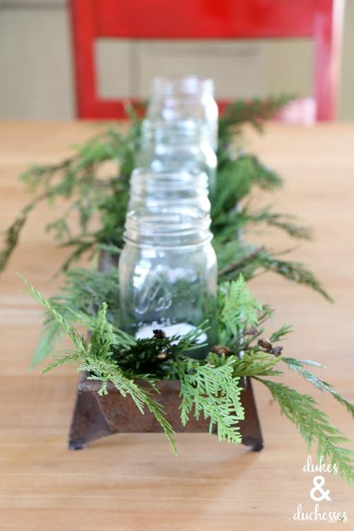 candles and cedar garland christmas decor