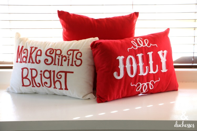 christmas pillows on window seat in kitchen