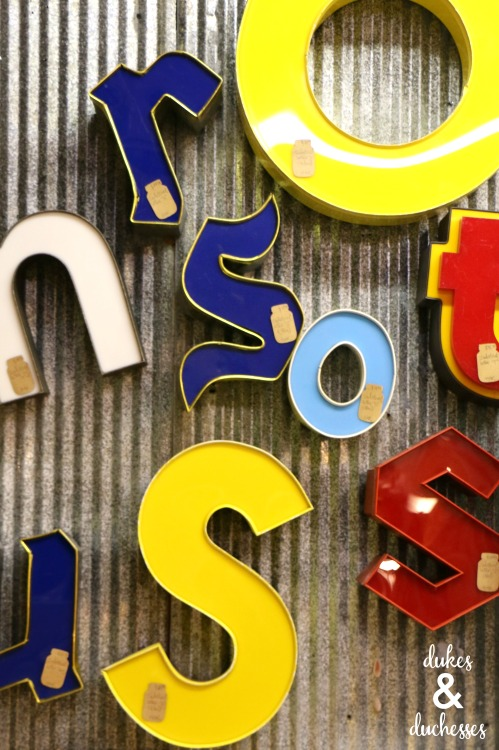 vintage marquee letters at pieces on the beach