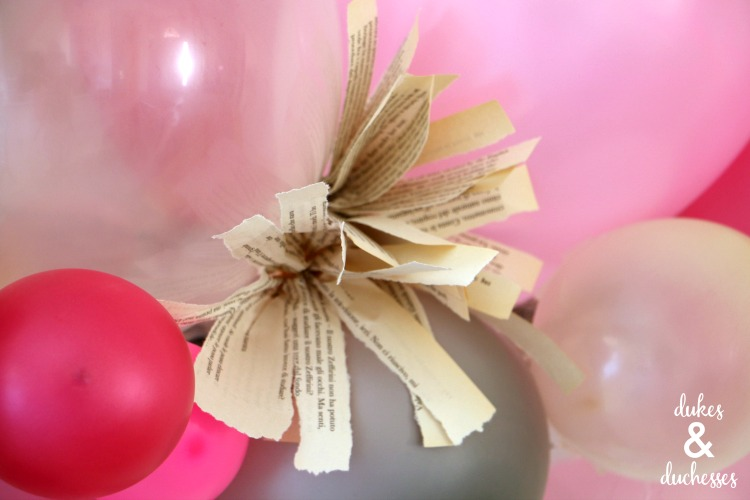 book page rosettes in balloon garland