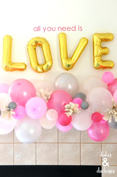 valentine's day mantel with balloon garland