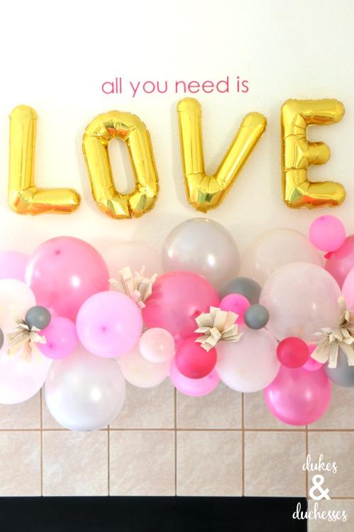 valentine's day mantel with balloon garland