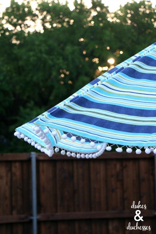 DIY embellished umbrella with pom pom trim