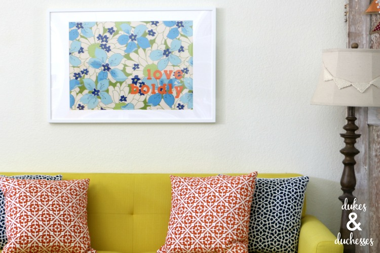 love boldly wall art in colorful family room