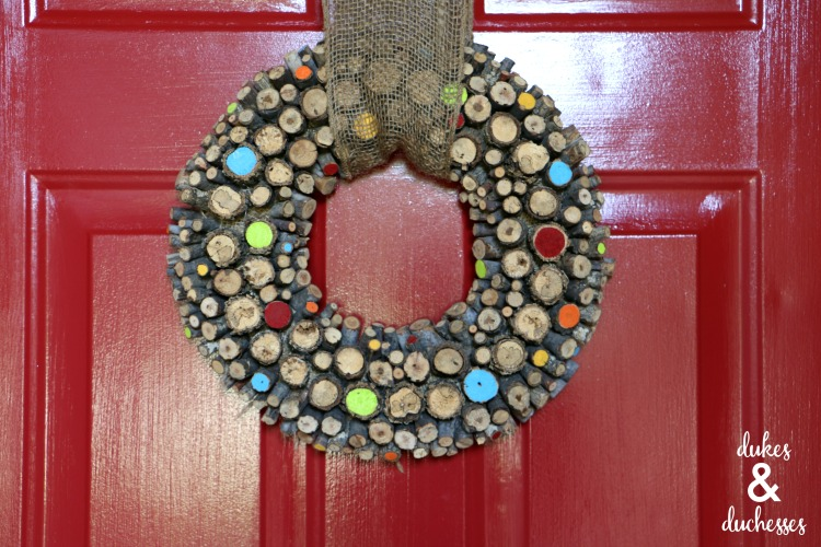 painted log wreath on red painted door