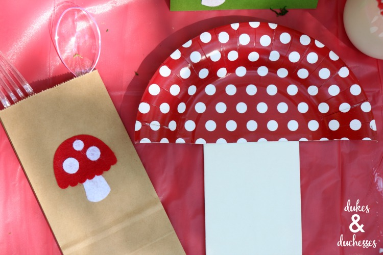 toadstool place settings made with paper plates and napkins