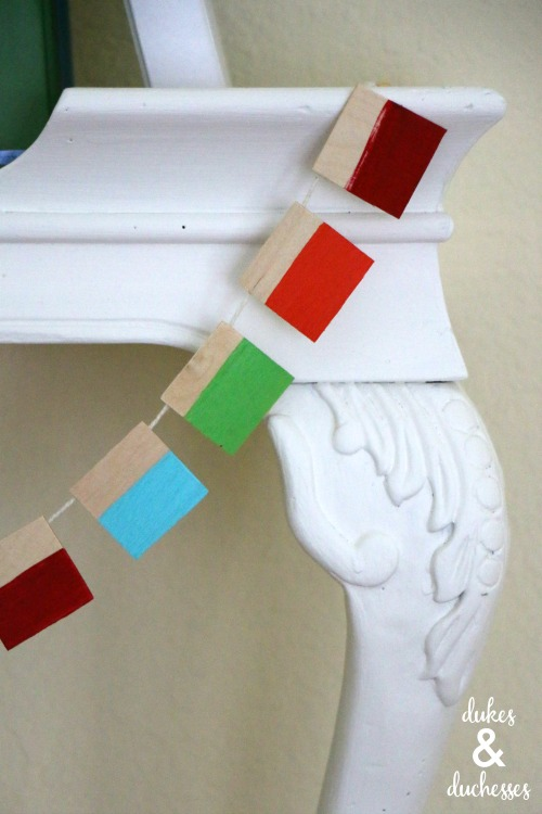 painted wood garland on upcycled shelf