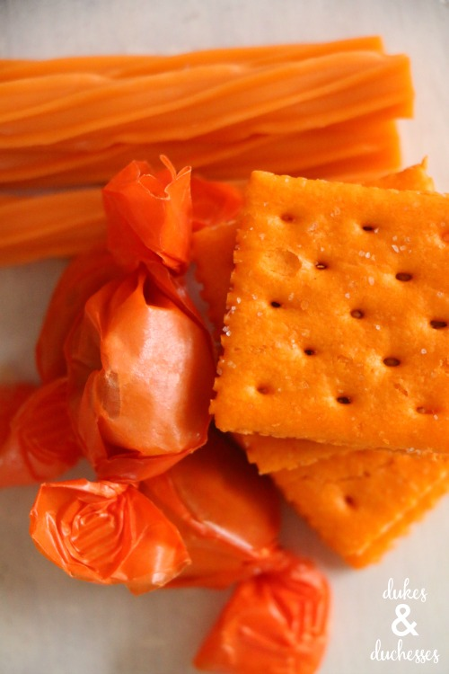 orange treats for candy corn halloween snack board