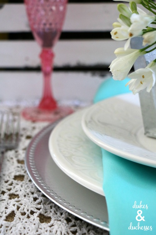 layered plates on spring tablescape
